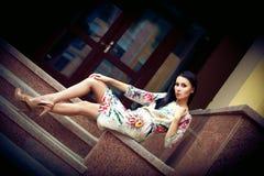 Stunning brunette sitting and posing Stock Photos