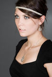 Stunning Brunette Teen. Shot of a Stunning Brunette Teenager against Grey Background Stock Photos