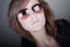 Stunning Brunette Teenager in Aviator Sunglasses Stock Photo