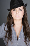 Stunning Brunette Teenager with Black Hat. Shot of a Stunning Brunette Teenager with Black Hat Royalty Free Stock Photos