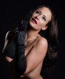 Stunning brunette wearing satin opera gloves. Stunning brunette wearing black satin opera gloves Stock Photo