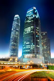 Stunning building over the glowing road. Futuristic skyscrapers standing out from the Hong Kong traffic lights at night Stock Photo