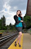 Stunning business woman waits for train Royalty Free Stock Photo