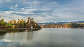 Stunning castle by the lake at dusk in autumn royalty free stock photos
