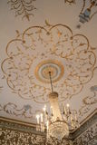 Stunning chandelier and artwork on ceilings of Dublin Writer's Museum,November,2014. Gorgeous craftsmanship of hanging chandelier and intricate artwork on the royalty free stock photography