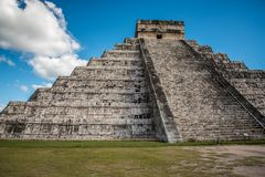 Stunning chichen itza mexico ancient civilization. Ancient mayan pyramid in yucatan mexico called chichen itza in december 2017. Blue sky and green grass. One of Stock Image