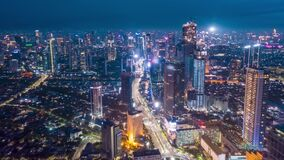 Stunning City View of Futuristic Skyline at Night, Skyscrapers in Asian Indonesian Capital Jakarta with flashing lights