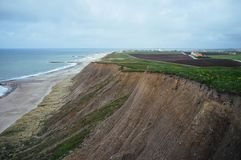 Stunning cliff separates fields and sea royalty free stock image