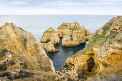 Stunning cliffs and arches in Ponta da Piedade, Lagos, Algarve,. Stunning cliffs and arches in Ponta da Piedade by Atlantic Ocean, Lagos, Algarve, Portugal Stock Photography