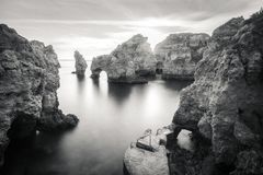 Stunning cliffs and arches in Ponta da Piedade, Lagos, Algarve,. Stunning cliffs and arches in Ponta da Piedade in black and white, Lagos, Algarve, Portugal Royalty Free Stock Photo