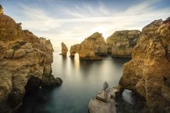 Sunrise over stunning cliffs and arches in Ponta da Piedade, Lag. Stunning cliffs and arches in Ponta da Piedade in the early morning, Lagos, Algarve, Portugal Stock Photo
