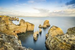 Stunning cliffs and arches in Ponta da Piedade, Lagos, Algarve,. Stunning cliffs and arches in Ponta da Piedade by Atlantic Ocean, Lagos, Algarve, Portugal Royalty Free Stock Photo