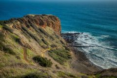 Stunning Cliffs of Inspiration Point. Stunning view of Inspiration Point cliff on a clear sunny day with waves crashing onto the rocks below Abalone Cove royalty free stock image