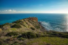 Stunning Cliffs of Inspiration Point. Stunning view of Inspiration Point cliff on a clear sunny day with waves crashing onto the rocks below Abalone Cove stock photo