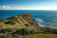 Stunning Cliffs of Inspiration Point. Stunning view of Inspiration Point cliff on a clear sunny day with waves crashing onto the rocks below Abalone Cove stock image