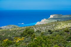 Stunning cliffs near Shipwreck Cove. Panoramic view of the cliffs near Navaggio Beach and Porto Limnionas in summer on Zante Island, Greece royalty free stock photo