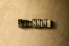 STUNNING - close-up of grungy vintage typeset word on metal backdrop. Royalty free stock - 3D rendered stock image.  Can be used for online banner ads and Royalty Free Stock Photo