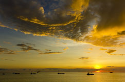 Stunning cloud formations with shipping. Stunning cloud formations in Makassar Straits, Indonesia with shipping in silhouette Royalty Free Stock Photo