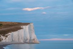 Stunning colorful dramatic Summer sunset over Seven Sisters land. Beautiful dramatic Summer sunset over Seven Sisters landscape in Englad Royalty Free Stock Photos