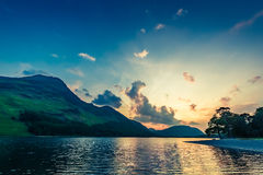 Stunning colorful dusk at lake in District Lake, England Royalty Free Stock Photography