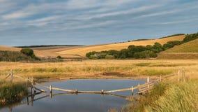 Stunning colorful Summer sunset over English countryside landsca. Beuaitufl vibrant Summer sunset over English countryside landscape Stock Photo