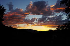 Stunning colorful sunset. Clouds over the Tuscany hills Stock Photography