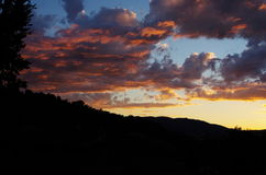 Stunning colorful sunset. Clouds over the Tuscany hills Stock Image