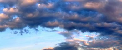 Stunning colorful sunset sky panorama showing beautiful cloud formations in high resolution. Seen in northern europe royalty free stock photos