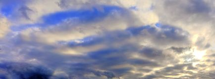 Stunning colorful sunset sky panorama showing beautiful cloud formations in high resolution. Seen in northern europe royalty free stock images