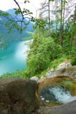 Stunning colorful waterfall falling to Konigsee known as Germany`s deepest and cleanest lake, located in Berchtesgadener National. Stunning colorful waters of royalty free stock photos