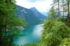 Stunning colorful waters of Konigsee known as Germany`s deepest and cleanest lake, located in Berchtesgadener National Park, Uppe. R Bavarian Alps, Germany royalty free stock photography