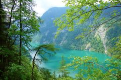 Stunning colorful waters of Konigsee known as Germany`s deepest and cleanest lake, located in Berchtesgadener National Park, Uppe. R Bavarian Alps, Germany royalty free stock photos