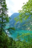 Stunning colorful waters of Konigsee known as Germany`s deepest and cleanest lake, located in Berchtesgadener National Park, Uppe. R Bavarian Alps, Germany royalty free stock image