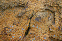 Stunning and colourful textured rockface Royalty Free Stock Image
