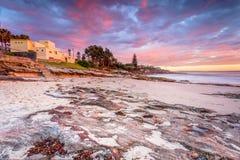 Sunrise skies over Cronulla coastline royalty free stock image