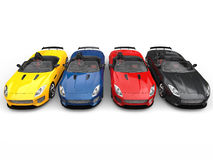 Stunning convertible modern sports cars in various colors - top down view. Isolated on white background Stock Image