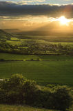 Stunning countryside landscape with sun beams Royalty Free Stock Image