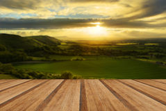 Stunning countryside landscape with sun lighting side of hills a Royalty Free Stock Images