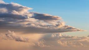 Beautiful cumulonimbus stormy rain cloud formations in Summer su. Stunning cumulonimbus storm and rain cloud formations in Summer sunset sky with dramatic moody Royalty Free Stock Photo