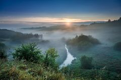 Stunning dawn at foggy valley in autumn, Poland stock images