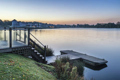Stunning dawn landscape image of clear sky over calm lake Royalty Free Stock Photos