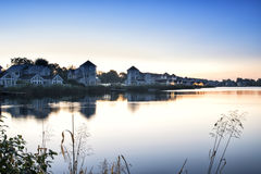 Stunning dawn landscape image of clear sky over calm lake Royalty Free Stock Images