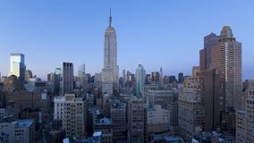 Stunning day to night time lapse panorama aerial steady shot of modern architecture in Manhattan New York cityscape