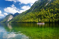 Stunning deep green waters of Konigssee, known as Germany`s deepest and cleanest lake, located in the extreme southeast Berchtesg. Adener Land district of royalty free stock photo