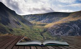 Stunning detail landscape image of mountain of Tryfan near Llyn Ogwen in Snowdonia during early Autumn coming out of pages of open. Beautiful detail landscape royalty free stock image