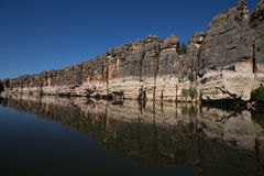 Stunning Devonian limestone cliffs of Geikie Gorge reflected in the Fitzroy River. Stunning Devonian limestone cliffs of Geikie Gorge where the Fitzroy River royalty free stock photos
