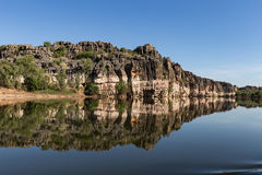 Stunning Devonian limestone cliffs of Geikie Gorge reflected in the Fitzroy River. Stunning Devonian limestone cliffs of Geikie Gorge where the Fitzroy River royalty free stock photo
