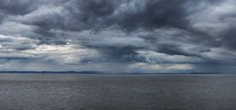 Stunning moody stormy sky over sea landscape Royalty Free Stock Image