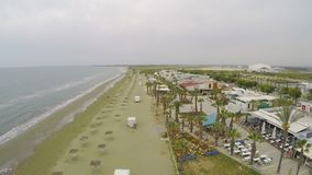 Stunning drone shot along empty beach near hotel in Cyprus, deserted area. Stock footage stock video