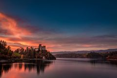 Stunning dusk over castle by the lake in Niedzica stock image